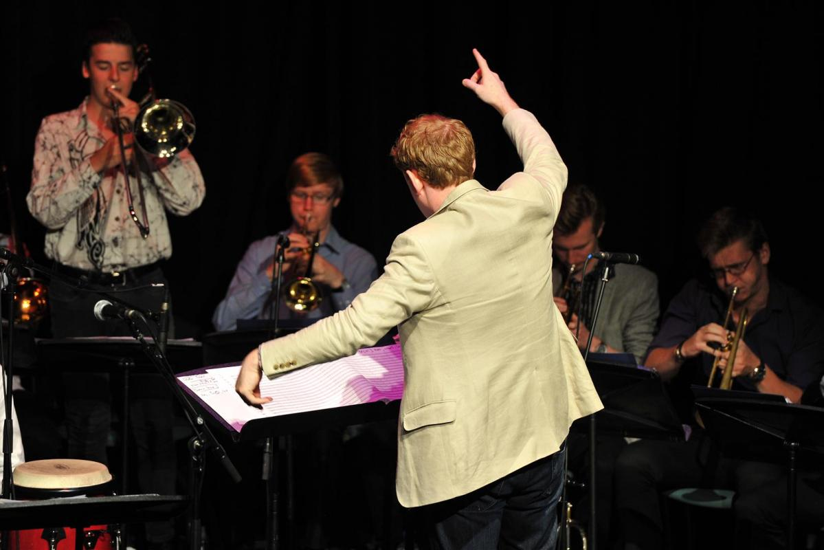 Artistic Director Andrew Bain leading the orchestra at Birnam Arts Centre