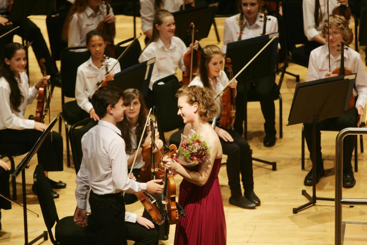 Soloist Jessica Coleman receives her bouquet after her sparkling performance