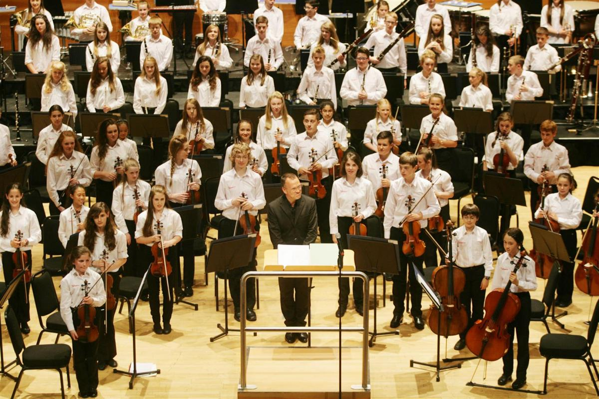 Roland Kieft congratulates the young players after a spirited performance, July 2014