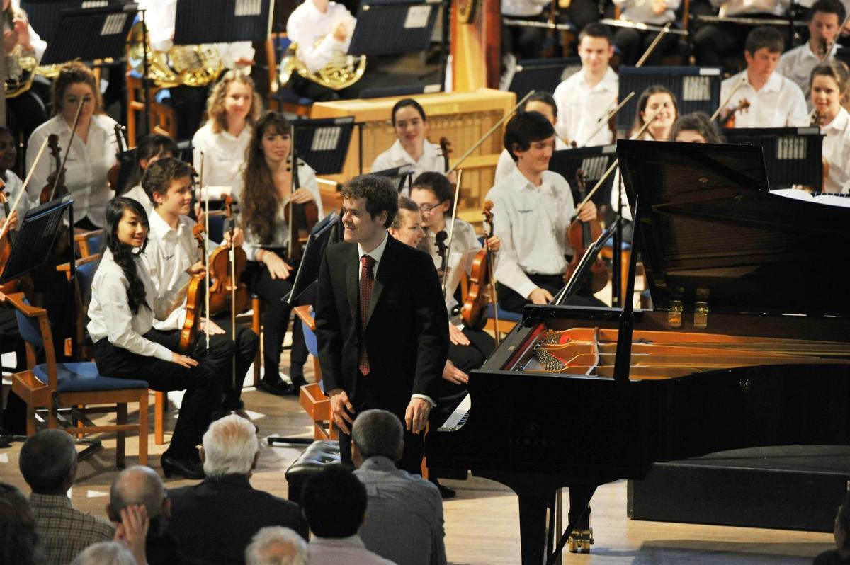 Pianist Benjamin Grosvenor taking his bow at Greyfriars Kirk 2014
