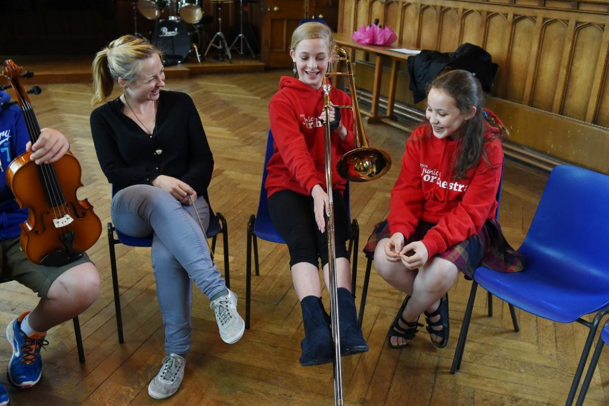 Conductor Holly Mathieson chats with musicians from NYOS Junior Orchestra