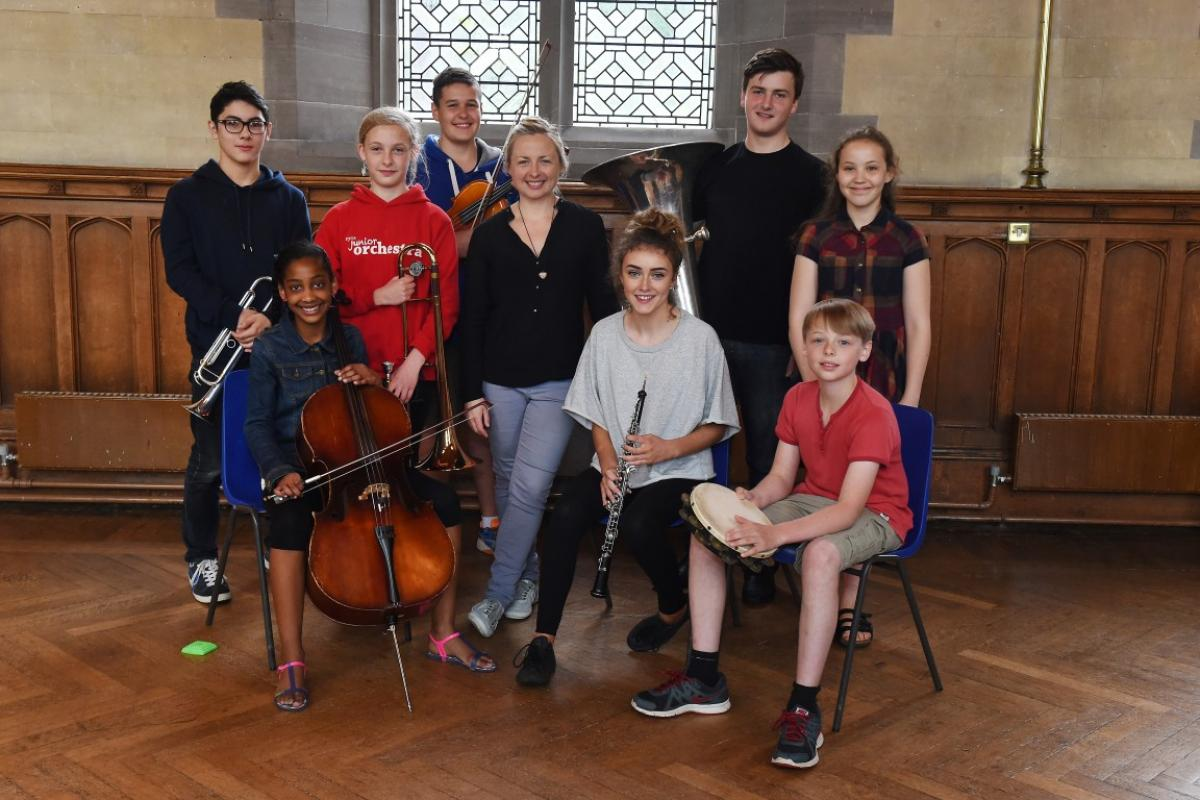 Conductor Holly Mathieson with musicians from NYOS Junior Orchestra