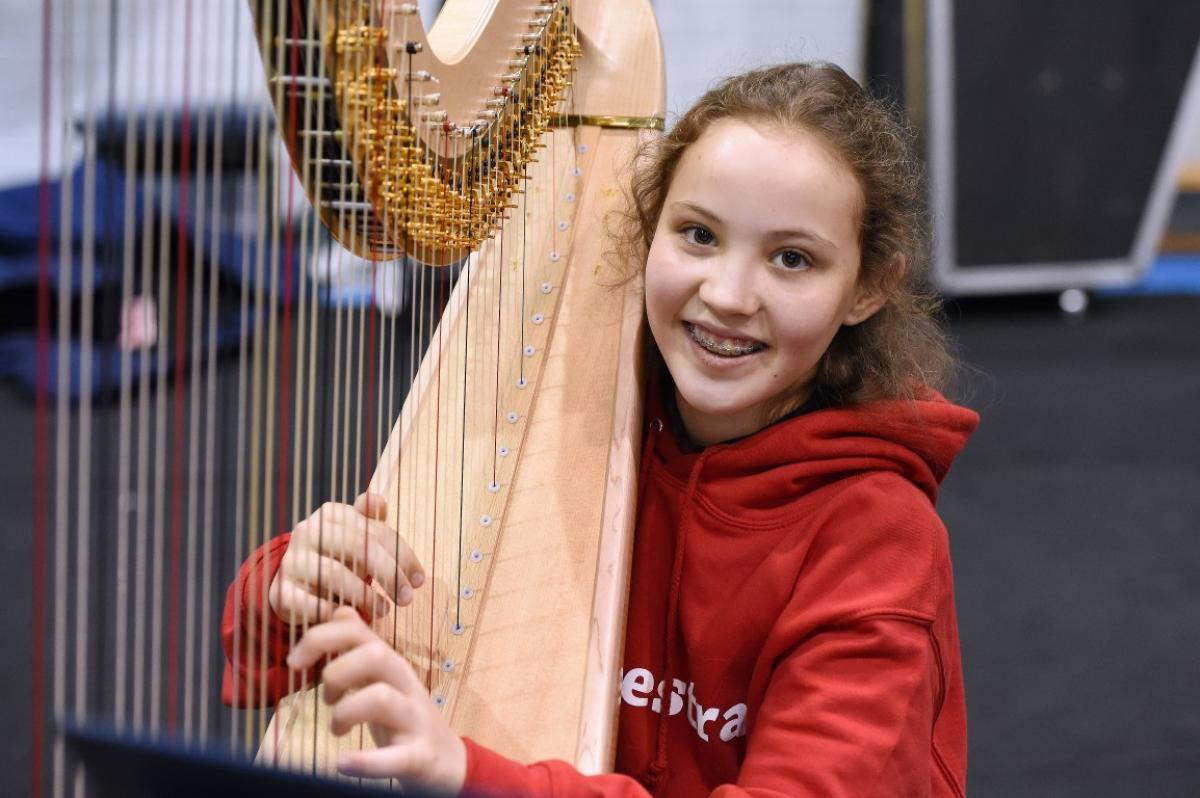 A very happy harpist rehearsing with NYOS Junior Orchestra in July 2015