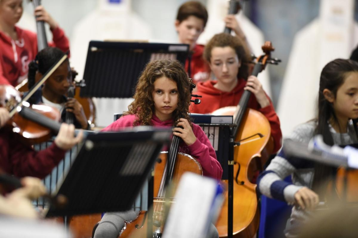 A young cellist rehearsing with NYOS Junior Orchestra at Strathallan School in July 2015