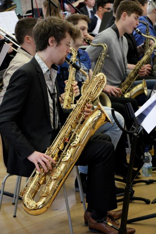 NYOS Jazz Orchestra baritone sax rehearsing ahead of the Double Big Band performance at Hallé St Peter's, Manchester