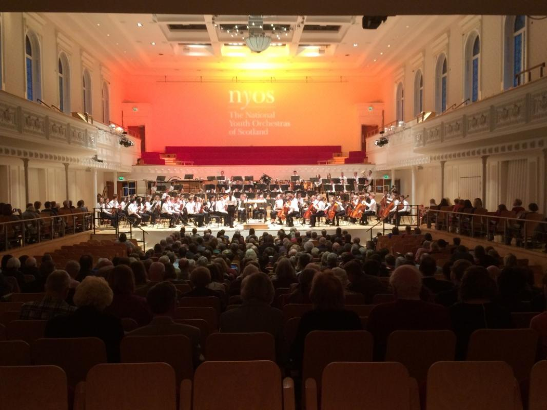 NYOS Senior Orchestra on stage, complete with new branded gobo above at Glasgow's City Halls, April 2017