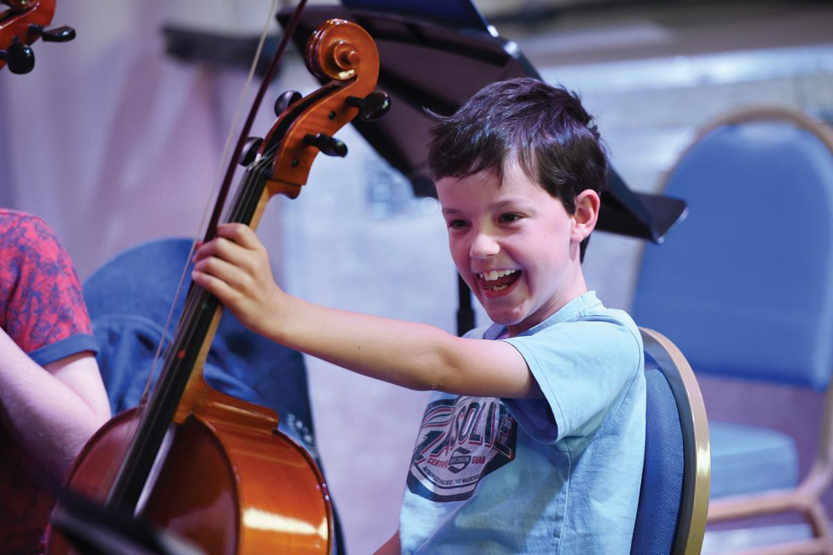 Young cellist developing in a strings ensemble