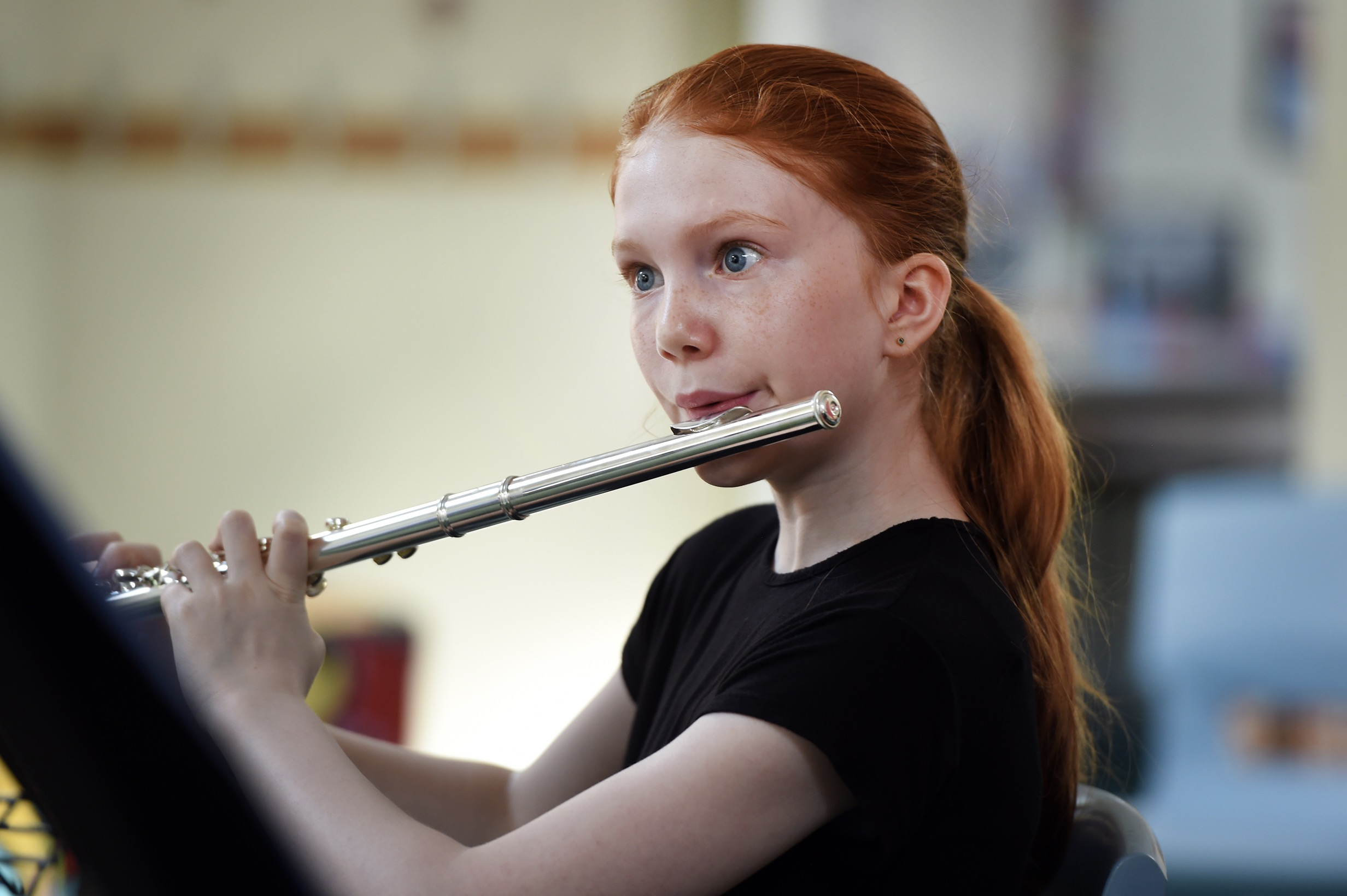 Young trombonist developing in the brass ensemble course